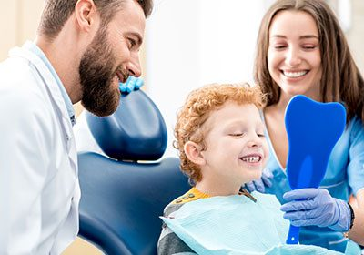 little-boy-and-mom-visit-the-dentist